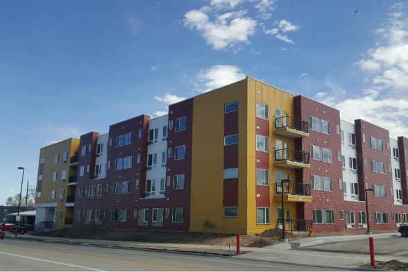 The four-story building includes 114 one- and two-bedroom units.