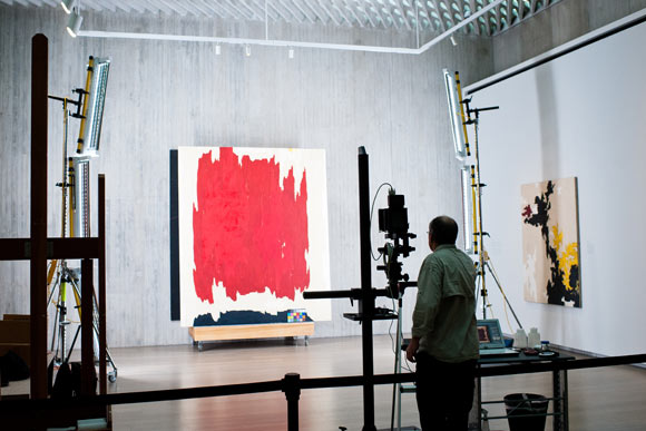 A Clyfford Still painting being photographed and catalouged.
