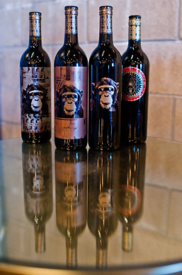 Four bottles of red wine produced by Infinite Monkey Theorem.