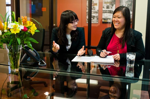 Helene Kwong goes over a University of Denver student's resume at Taopivot.