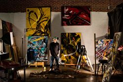 Jolt, a Denver graffiti artist, poses in his studio space.