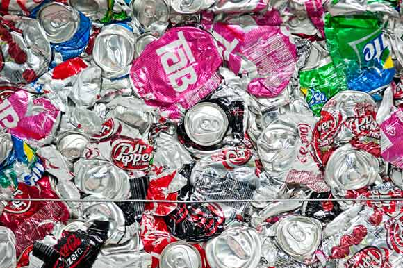Crushed cans in the recycling area of the Coca-Cola bottling plant.