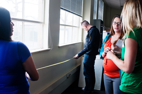 CSU Supply Chain Management students take measurements for recycling bins.