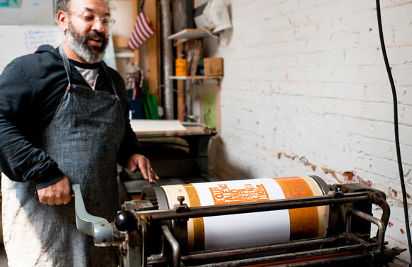 MATTER owner Rick Griffith runs the letterpress machine.