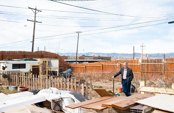James Bertini stands in his backyard in the Baker neighborhood.