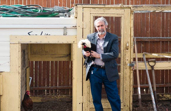 James Bertini poses with one of his chickens.