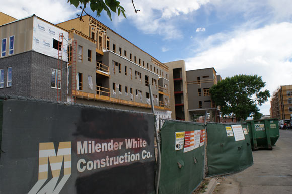 Nine hundred new units are being built, tripling the neighborhood's density.