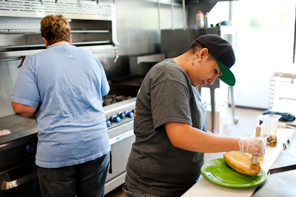 Women cook on the link at the Osage Cafe.