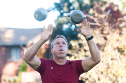 Gus Peterson juggles kettlebells, and teaches his clients to do the same.