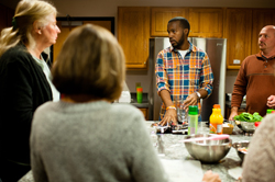 Dennis Taylor, program coordinator, teaches a signature cooking class.