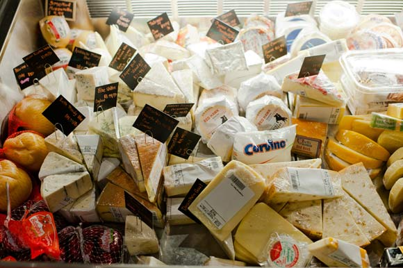 Mondo Market offers a collection of cheeses and specialty foods.