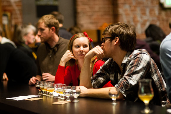 A couple enjoys flights of beer at Crooked Stave Artisan Beer Project.