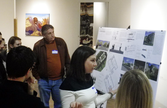 Korey White of Park21 Architecture explains her design to the judges.