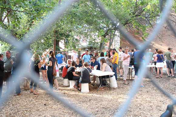 Cleanup volunteers enjoy a pop-up beer garden in Five Points Alley in Cincinnati.