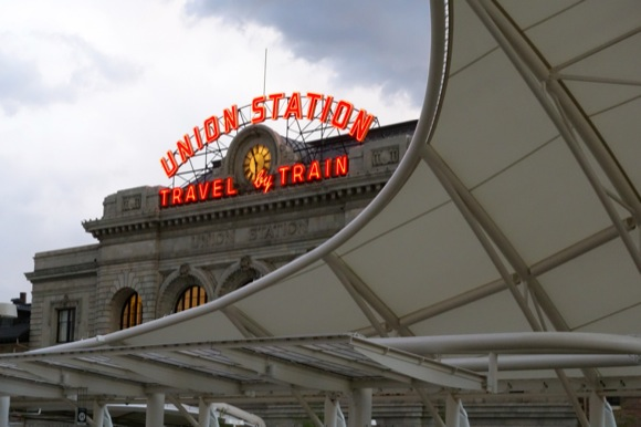 The canopy on the rail platform harks to the architecture at Denver International Airport.
