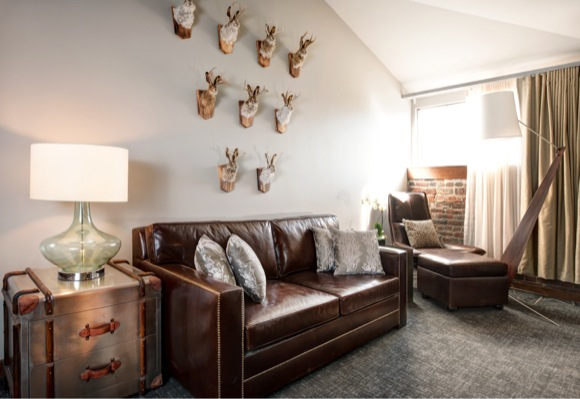 Jackalope taxidermy handpicked by NINE dot ARTS decorates a room at The Crawford Hotel.