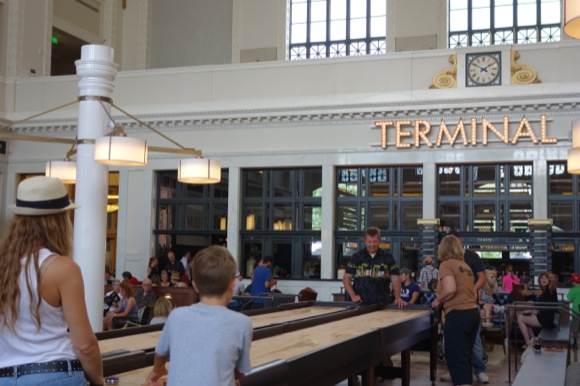 In the Great Hall, shuffleboard play gets serious on opening day.