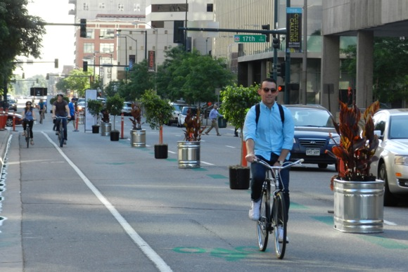 The pop-up protected bike lane on Arapahoe Street could soon become permanent.