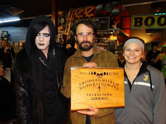 Ian Gray (left) makes hand-painted Ouija boards.