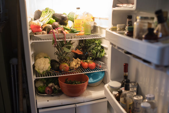 Living a vegan lifestyle, their fridge is filled with fruits and vegetables.