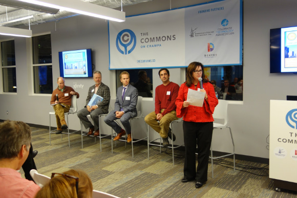Moderator Christine Marquez-Hudson introducing the panel.