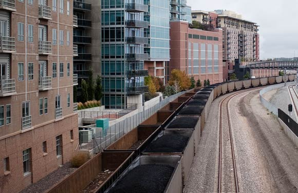 Denver's railroad is in places an industrial gash cutting through a vibrant city.