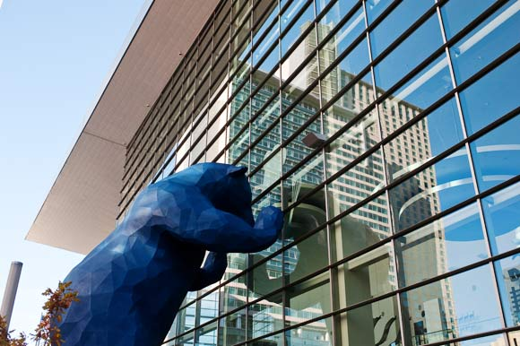 "Lawrence Argent's ""I See What You Mean,"" a.k.a. The Big Blue Bear, peers into the convention center."
