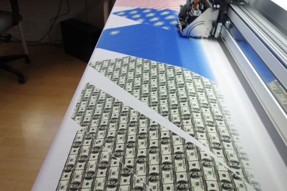 Knotty Tie printed monetary themes on fabric in honor of Lew's visit.