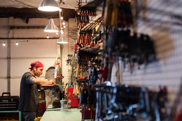 vast assortment of tools hangs on the wall of DTL's 1,000-square-foot warehouse.