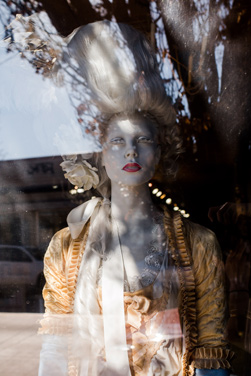 A mannequin stares out of Rebelle Salon.