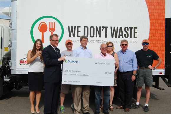 CoBank presents Arlan Preblud of We Don't Waste with a big donation.