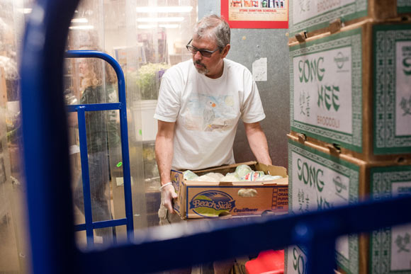 George Mayfield picks up food at Sprouts while volunteering with Denver Food Rescue.