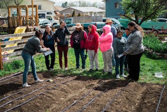 "Re:Vision helped educate locals on backyard farms, or ""promotoras."""