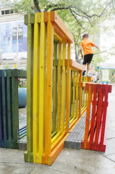 A kid finds another use for Rainbow Street Seating.