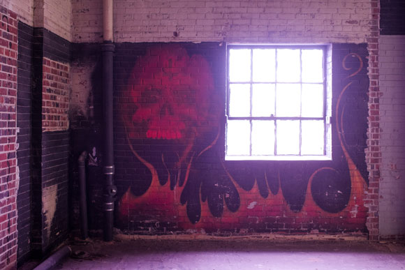 A motorcycle club met in the warehouse when it was vacant, and they left their mark.