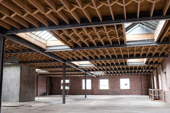The site includes the largest remaining undeveloped exposed brick-and-timber warehouse in Denver.