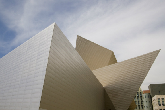 The summit takes place at the Denver Art Museum.
