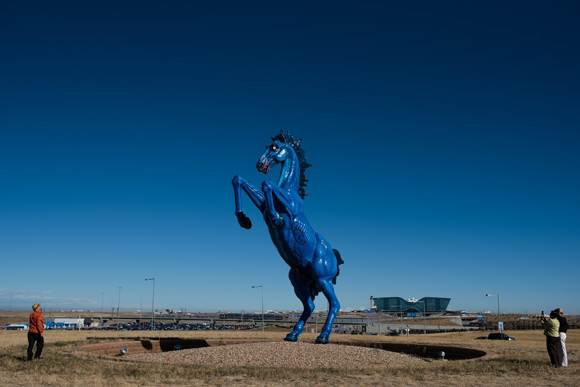 The sculpture is 32 feet tall and weighs 9,000 pounds.