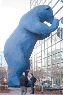 Lawrence Argent is best known in Denver for his sculpture, I see what you mean, the blue bear standing 40 feet high and pressing itself up against the Colorado Convention Center.